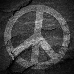 Peace sign grunge background textured on stone wall