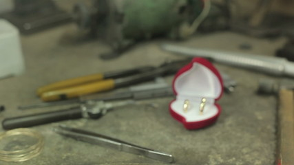 golden wedding rings in a red box,  on the desktop