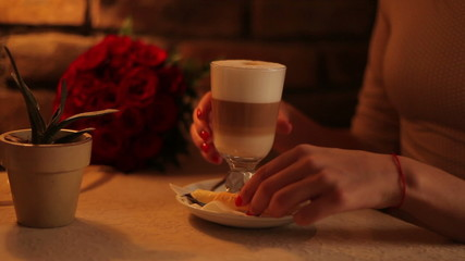 woman drinking coffee latte in a cafe