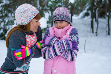 girls have frozen, mother and daughter in the cold winter forest