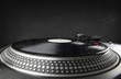 canvas print picture - Turntable playing vinyl close up with needle on the record