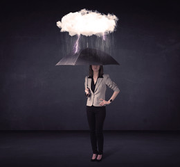 Businesswoman standing with umbrella and little storm cloud