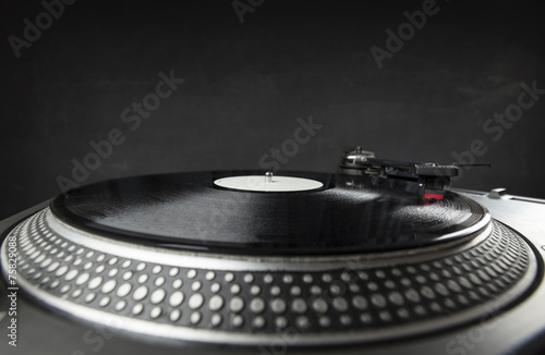 canvas print picture Turntable playing vinyl close up with needle on the record