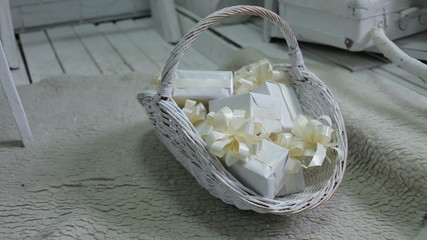 decorated wicker basket filled with christmas gifts