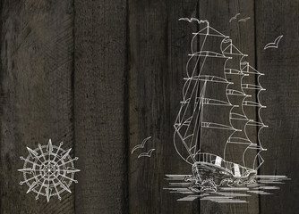 Old planks with ship and wind rose drawing