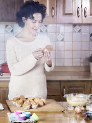 Woman eating a homemade fresh cupcake in the morning