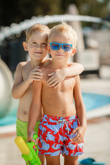 Two Boys Having fun at the Pool. Summer Vacation Fun.
