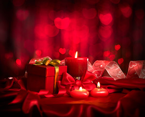 Valentine's Day. Valentine red hearts, red candles and gift box