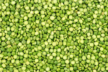 Macro background texture of vibrant green split peas