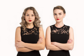 Two women in identical dresses are angry at each other