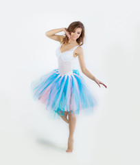young beautiful gentle girl dancer posing on white background