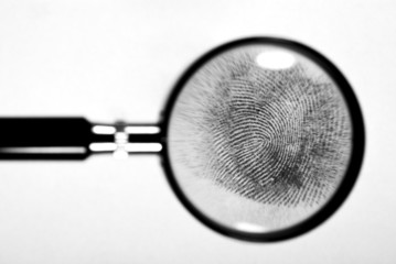 Fingerprint on white paper.