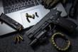 Leinwanddruck Bild - pistol on the table