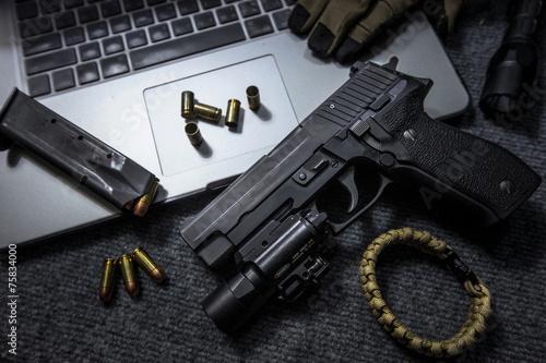 Leinwanddruck Bild pistol on the table