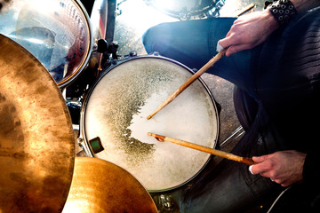 Man playing the drum.Live music background concept.Drummer
