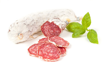 Salami sliced on the white background