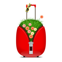 Suitcase with grass and flowers
