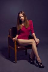 Young beautiful woman in scarlet  kombidress.  Fashion model sho