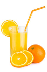 Orange juice in glass beaker with straw