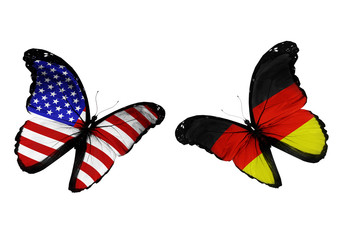 Concept - two butterflies with German and USA flags
