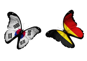 Concept - two butterflies with South Korea and Belgium flags