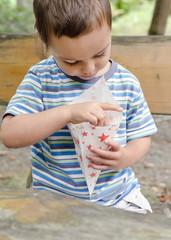 Child eating popcorn outdoor