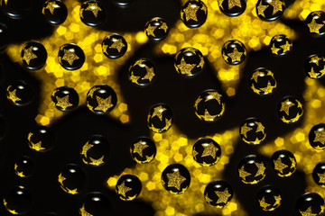 water droplets with reflections of golden stars