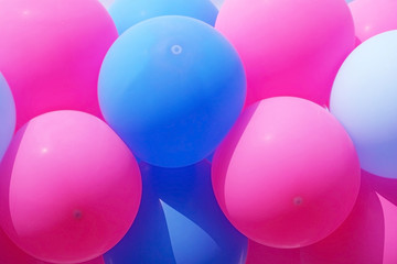 Pink and blue balloons for background