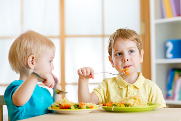 kids eating in kindergarten or at home
