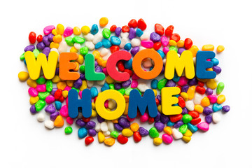 welcome home word in colorful stone