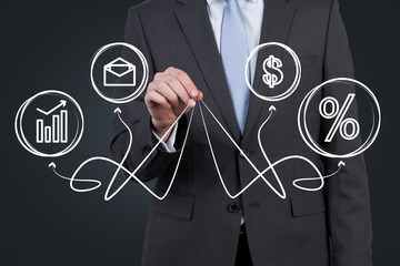 businessman holding business symbols