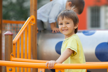 Child on the playground, having fun