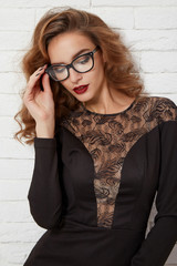 Beautiful sexy woman in stylish glasses for vision