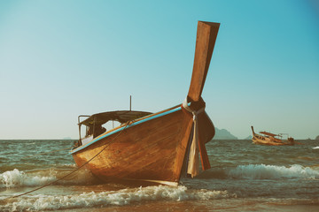 Traditional longtail wooden boat, retro toned