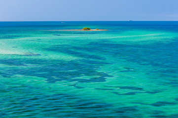 Water of tropical sea and tiny coral reef on background
