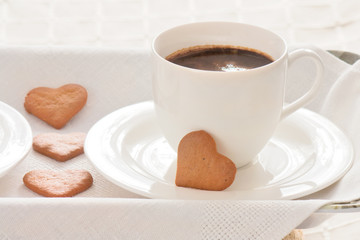 Cup of coffee and hearts.