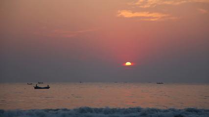 Sunset on the beach of the Arabian Sea Goa India.