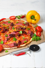 Hot baked pizza with different ingredients on wooden table