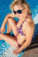 woman in sunglasses in luxury pool