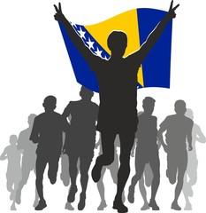 Athlete with the Bosnia and Herzegovina flag at the finish