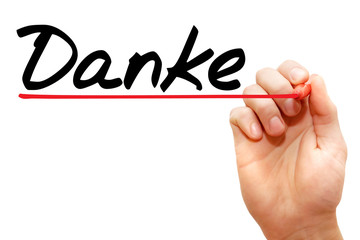 Hand writing Danke with marker, business concept