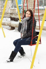Smiling woman outside in winter