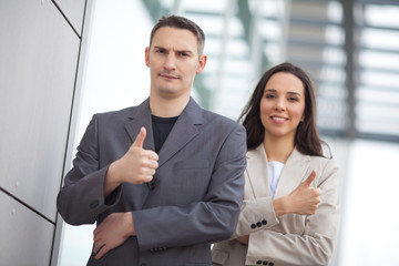 A confident businessman with his female colleague