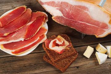 Parma ham (jamon) sliced on a white background