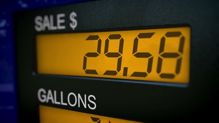 Zoom in on gas pump display with rising numbers starting at 28