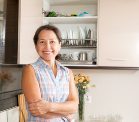 woman relaxing at  kitchen