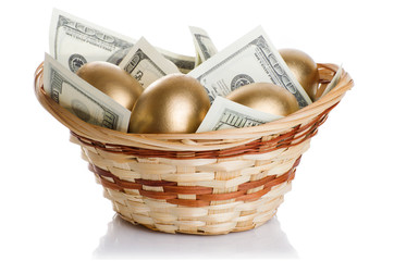 golden eggs and dollars in a basket isolated on white background