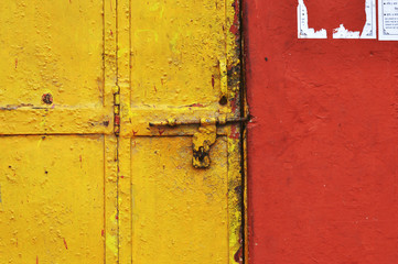 Vintage front door and red wall in India