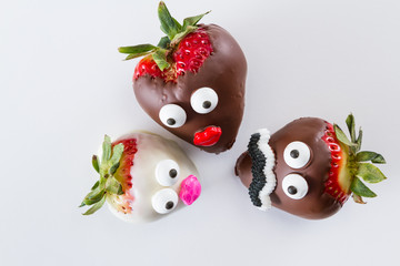 strawberries with faces
