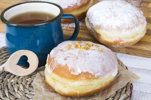 Classic glazed doughnuts and mug of tea - 75853294